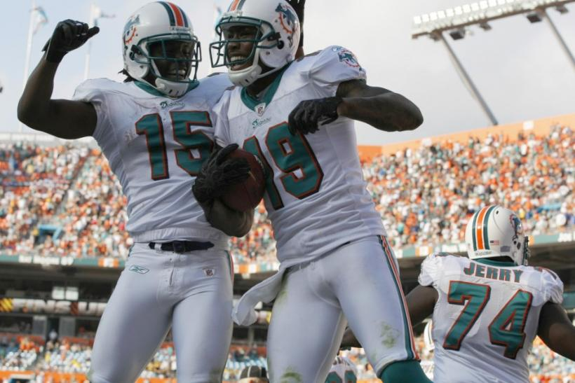 Miami Dolphins Davone Bess celebrates with teammate Brandon Marshall after Marshall scored a touchdown against the Buffalo Bills during fourth quarter NFL football game in Miami