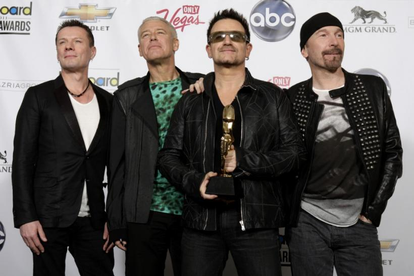 Members of the band U2 pose in the photo room after winning the Top Touring award during the 2011 Billboard Music Awards show in Las Vegas