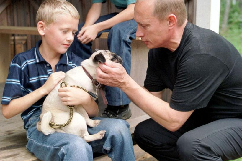 RUSSIAN PRESIDENT PUTIN PATS THE DOG ON THE HEAD IN VERKHNIE MONDROGI.