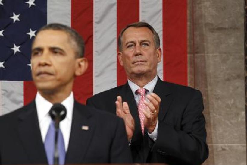Speaker of the House John Boehner applauds as President Barack Obama addresses a joint session of Congress about jobs creation.