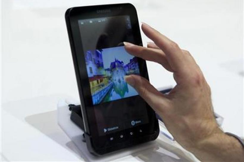 Man uses touch screen of Samsung's Galaxy Tab tablet device at IFA consumer electronics fair in Berlin