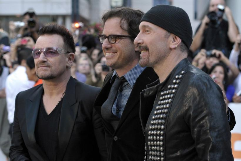 U2's Bono and The Edge pose with director Davis Guggenheim at gala presentation for documentary film at 36th Toronto International Film Festival