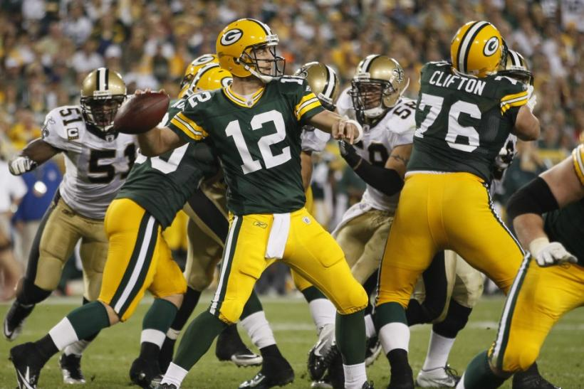 Green Bay Packers quarterback Aaron Rodgers throws a pass against the New Orleans Saints during the second half of their NFL football game in Green Bay