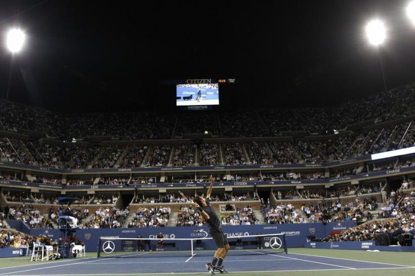 Federer serves to Tsonga during their quarterfinal match at the U.S. Open tennis tournament in New York