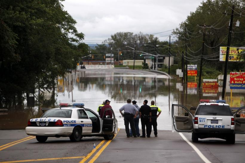 Law enforcement officers look at flooding from the Susquehanna River in Kingston, Pennsylvania