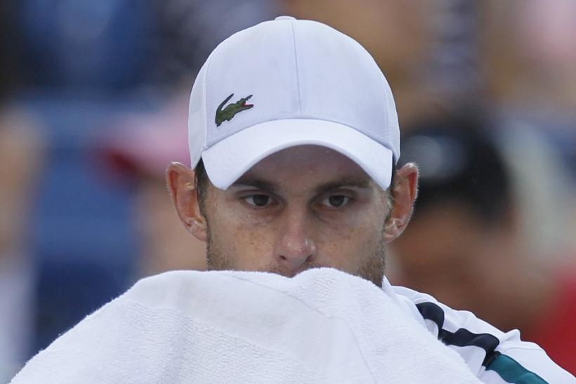 Andy Roddick of the U.S. wipes his face during a break in play against Rafael Nadal of Spain in their match at the U.S. Open tennis tournament in New York