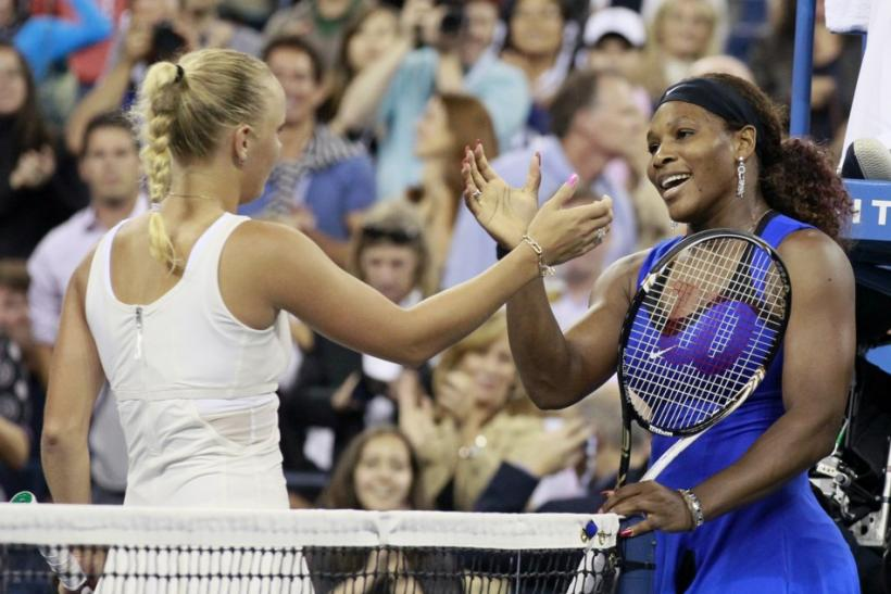 Serena Williams of the U.S. shakes hands at the net with Caroline Wozniacki of Denmark after winning their semi-final match at the U.S. Open tennis tournament in New York