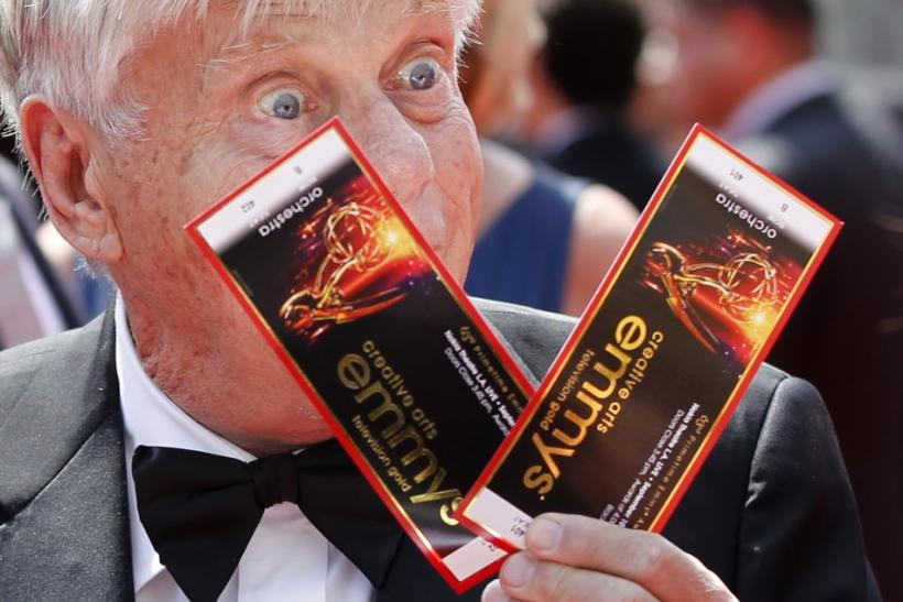 Actor Robert Morse holds up his tickets as he arrives at the 2011 Primetime Creative Arts Emmy Awards in Los Angeles