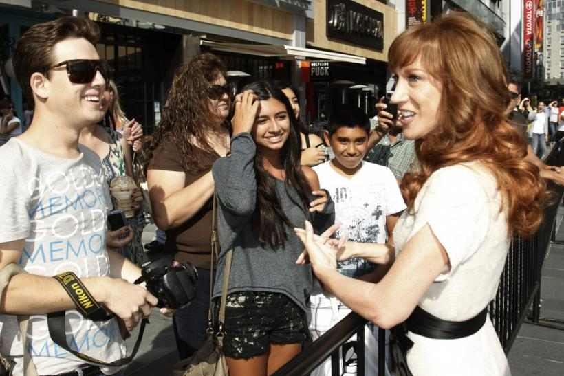 Comedienne Kathy Griffin greets fans as she arrives at the 2011 Primetime Creative Arts Emmy Awards in Los Angeles