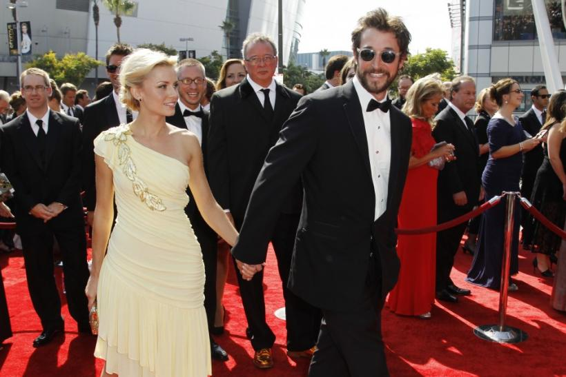 Actor Noah Wyle (R) and actress Sara Wells arrive at the 2011 Primetime Creative Arts Emmy Awards in Los Angeles
