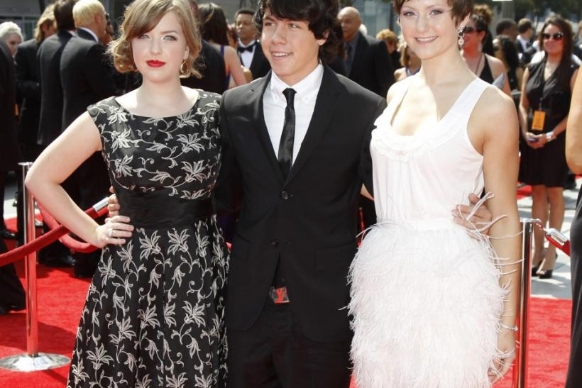 "Canadian actors Aislinn Paul (L), Munro Chambers, and Jordan Todosey from ""Degrassi"" arrive at the 2011 Primetime Creative Arts Emmy Awards in Los Angeles"