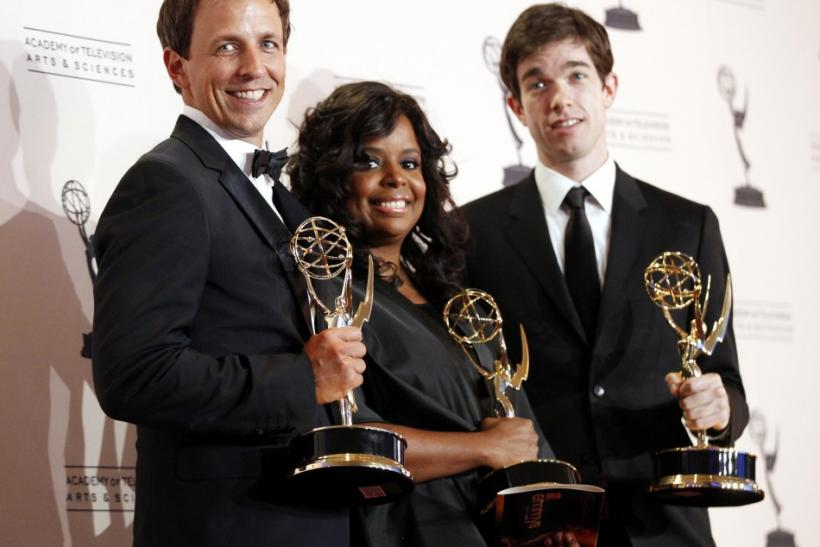 "Actors Seth Meyers (L), writer Katreese Barnes (C), and writer John Mulaney (R) pose with their awards for Outstanding Original Music and Lyrics for the ""Saturday Night Live"" song ""Justin Timberlake Monologue"" backstage at the 2011 Pri"