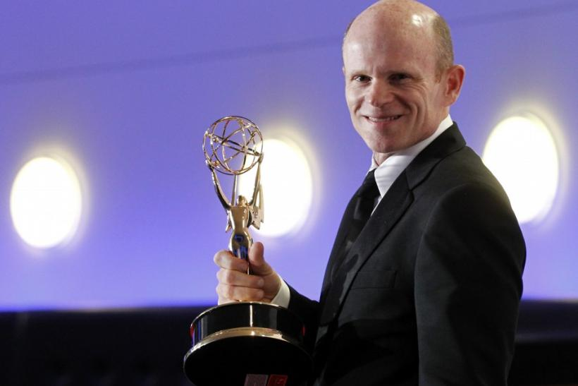 "Paul McCrane poses backstage with his Outstanding Guest Actor In A Drama Series award for his work on ""Harry's Law"" at the 2011 Primetime Creative Arts Emmy Awards in Los Angeles"