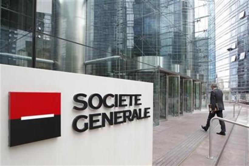 An employee enters the headquarters of French bank Societe Generale at La Defense, west of Paris