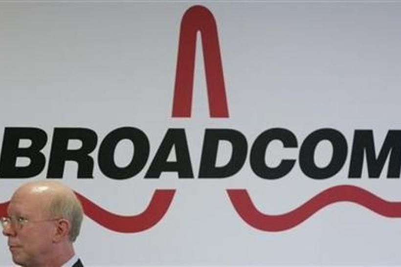 Broadcom Corporation President and Chief Executive Officer Scott McGregor stands in front of the company's logo in Taipei March 18, 2010.