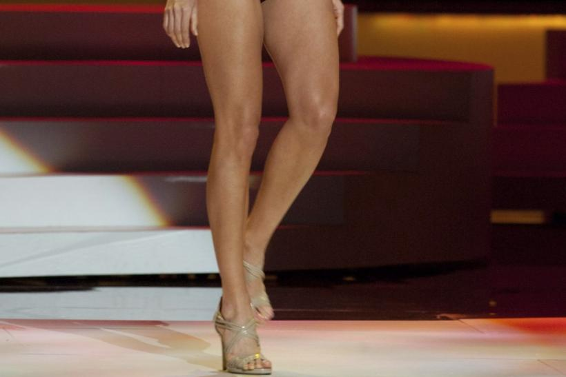 Miss Universe Malaysia 2011 Deborah Henry wears a swimsuit during a presentation show at the Credicard Hall in Sao Paulo