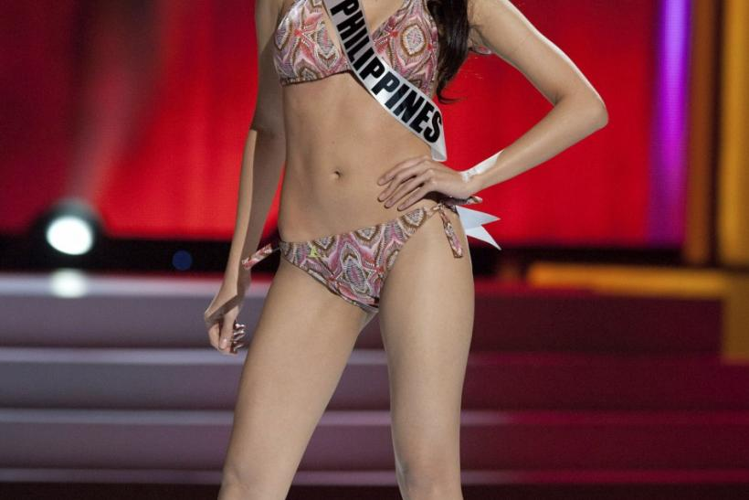 Miss Universe Philippines 2011 Shamcey Supsup wears a swimsuit during a presentation show at the Credicard Hall in Sao Paulo
