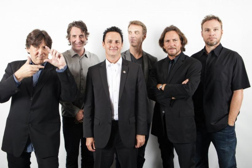 Director Crowe poses with embers of the band Pearl Jam in Toronto