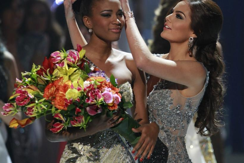Miss Angola Leila Lopes is crowned by Miss Universe 2010 Ximena Navarrete of Mexico after being named Miss Universe 2011 in Sao Paulo