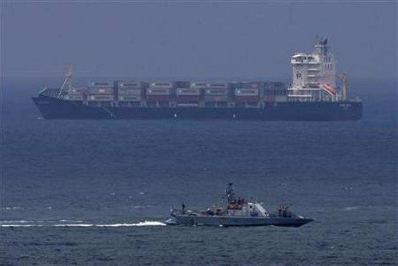 An Israeli naval vessel (front) patrols near the port of Ashdod