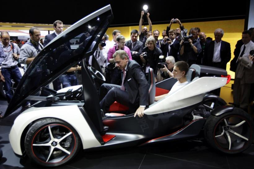 Karl-Friedrich Stracke, CEO of Adam Opel AG poses inside the full electric vehicle 'Opel RAK e' concept car at the International Motor Show (IAA) in Frankfurt