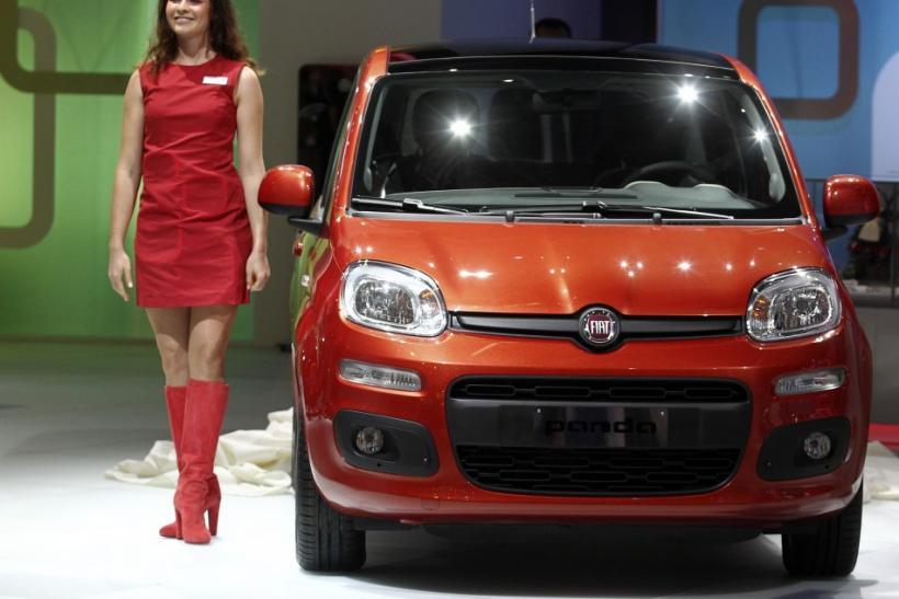 Models pose at the Fiat exhibition booth in front of a Fiat Panda during the International Motor Show (IAA) in Frankfurt