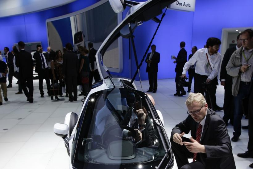 "Visitors look at the German car manufacturer Volkswagen (VW) concept car ""Nils"" at the VW exhibition booth during the International Motor Show (IAA) in Frankfurt"