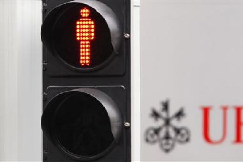 A file photo of a traffic sign next to an UBS bank logo in Zurich