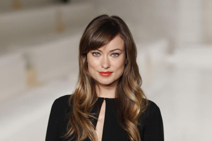 Actress Olivia Wilde poses for a photograph before watching the Ralph Lauren Spring/Summer 2012 collection during New York Fashion Week