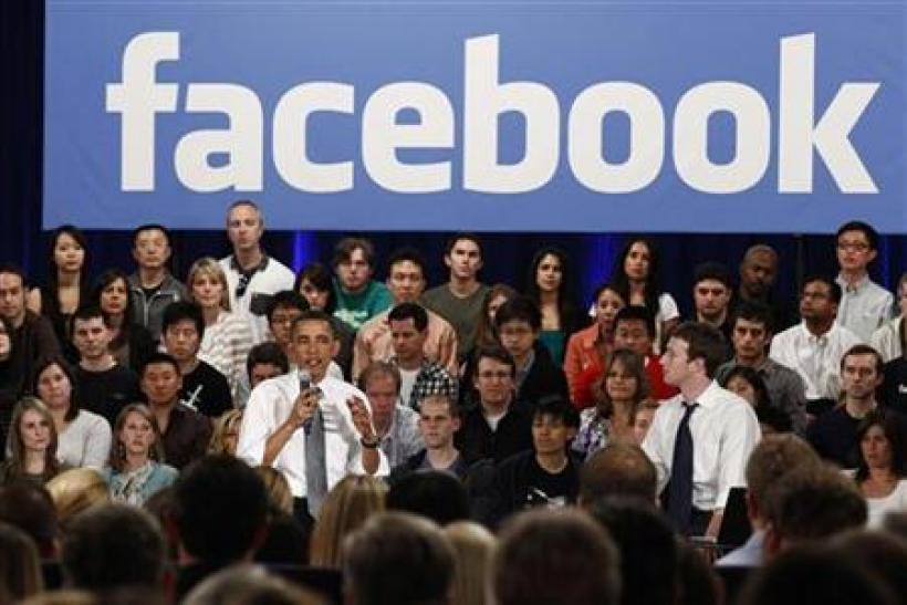 U.S. President Barack Obama attends a town hall meeting at Facebook headquarters with CEO Mark Zuckerberg in Palo Alto