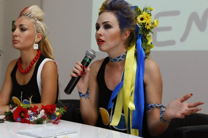 An Ukrainian activist from women's rights organisation Femen speaks to the media after their performance in Warsaw