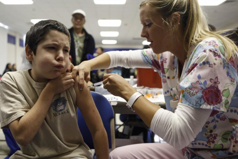 Adams, 10, reacts as nurse Fawna Dougoud administers his shot of the H1N1 vaccine in Haltom City