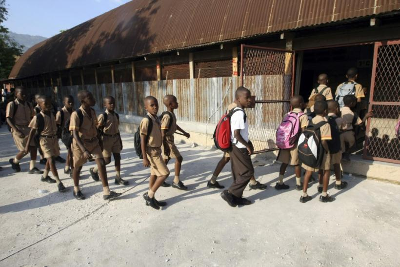 Students walk into Kindergarten Frere Polycarpe du Sacre-Coeur in downtown Port-au-Prince