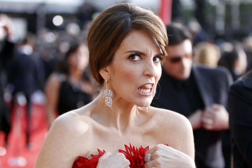 Actress Tina Fey adjusts her dress as she arrives at the 17th annual Screen Actors Guild Awards in Los Angeles