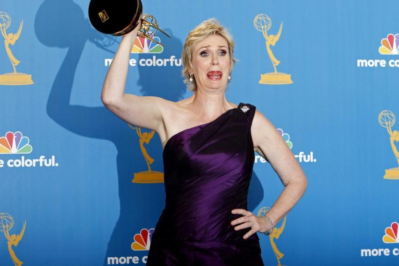 Jane Lynch, winner for outstanding supporting actress in a comedy series, poses with her award backstage at the 62nd annual Primetime Emmy Awards in Los Angeles