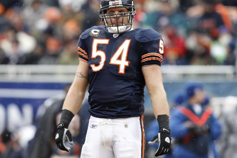Bears' Urlacher pauses during a break in play between the Bears and the Seahawks in their NFC Divisional NFL playoff football game in Chicago