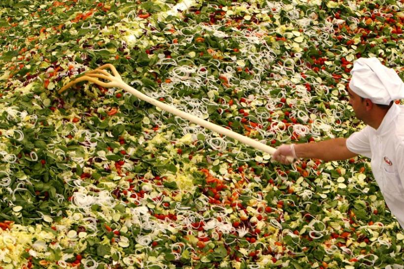 A cook prepares the world's biggest green salad