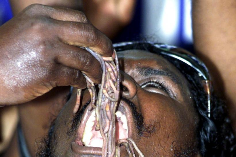 An Indian man swallows worms to set a new Guinness world record