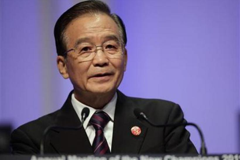 China's Premier Wen Jiabao delivers a speech at the opening ceremony of WEF meeting in Dalian
