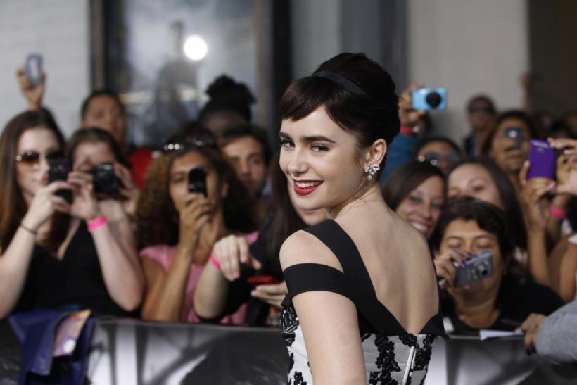 "Cast member Lily Collins poses during the world premiere of ""Abduction"" at the Grauman's Chinese theatre in Hollywood, California"