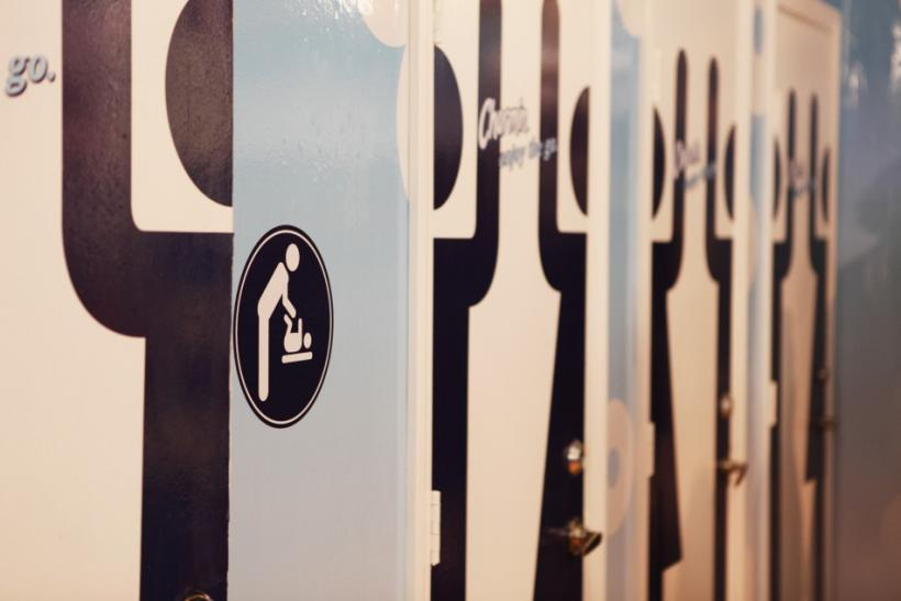 Doors to new toilets are displayed at a promotional event for Charmin Restrooms in New York's Times Square