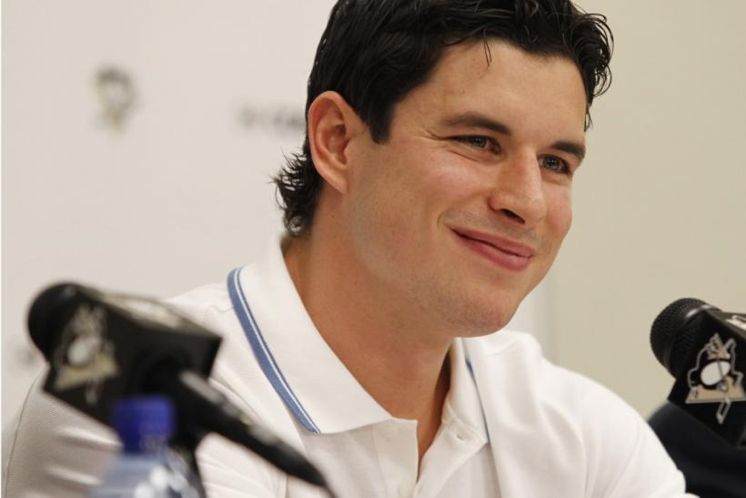 Pittsburgh Penguins' Crosby smiles at a reporter's question during a news conference at Consol Energy Center in Pittsburgh