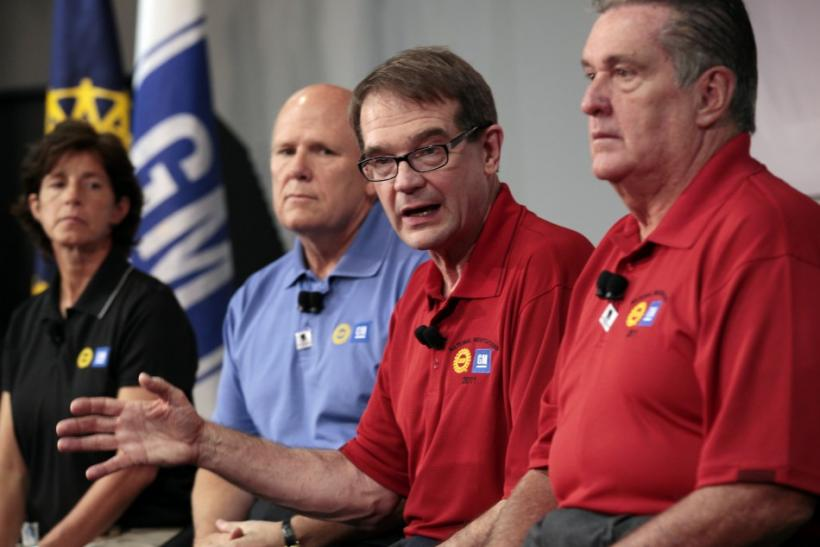United Auto Workers Union President Bob King addresses media as GM Chairman and CEO Akerson, GM VP of Labor Relations Clegg and UAW VP UAW-GM department Ashton listen at Detroit-Hamtramck assembly plant