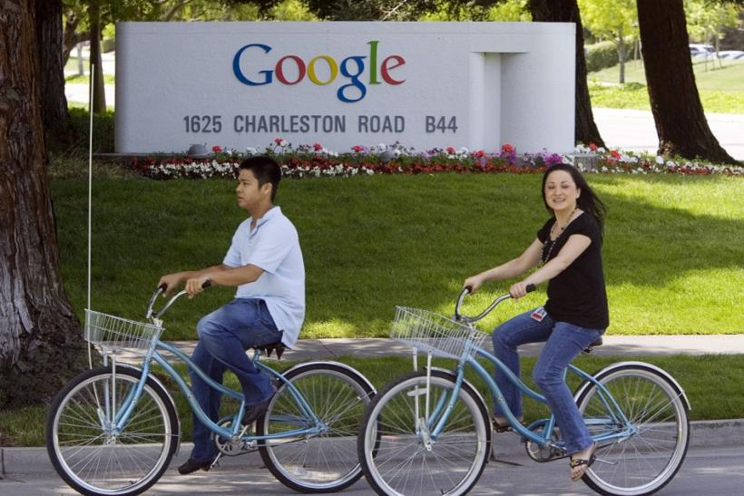 People ride their bikes past Google Inc. headquarters in Mountain View