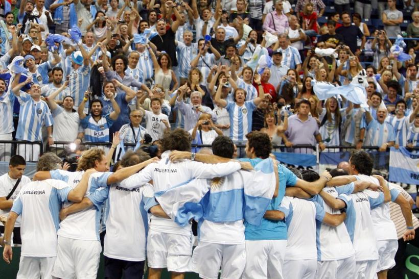 Argentina's players celebrate after beating Serbia in their Davis Cup World Group tennis semi-final match in Belgrade
