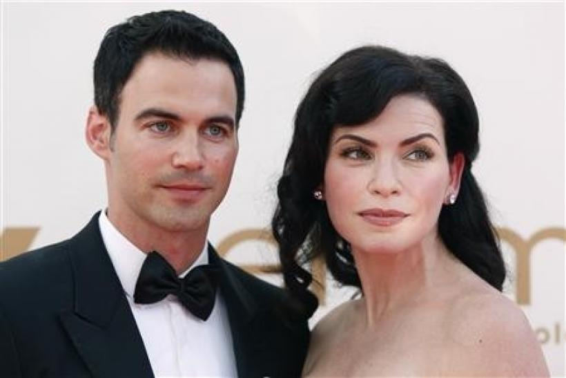 Actress Julianna Margulies from television series ''The Good Wife'' and her husband Keith Lieberthal arrive at the 63rd Primetime Emmy Awards in Los Angeles