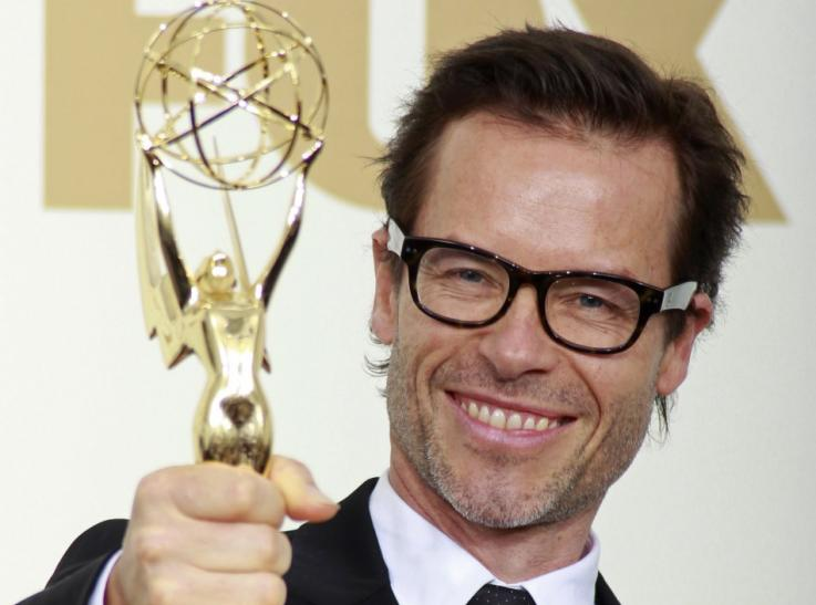 "Australian actor Guy Pearce holds his Emmy award for supporting actor in a miniseries or a movie, for ""Mildred Pierce,"" at the 63rd Primetime Emmy Awards in Los Angeles"