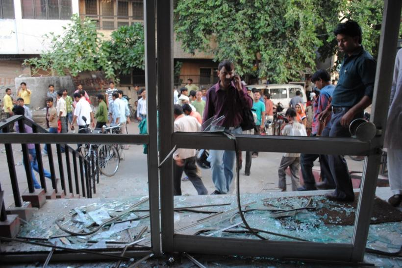 Onlookers stand at the site of a blast in Agra