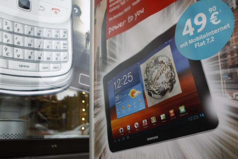 A poster advertising a Samsung tablet is pictured at a mobile phone shop in Duesselorf