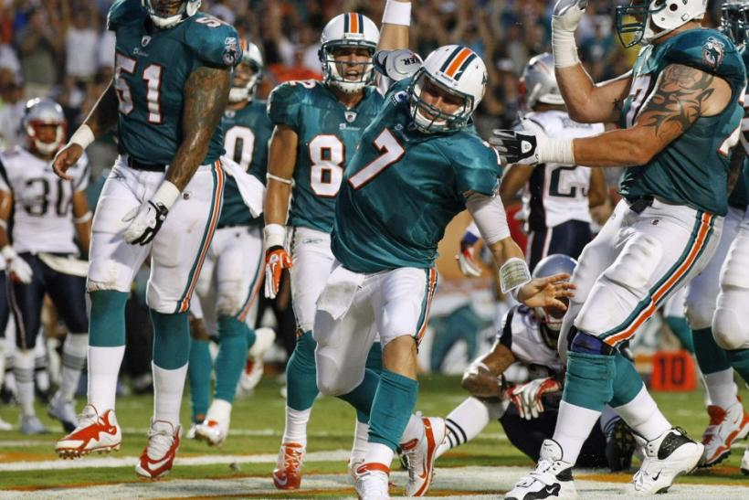 Dolphins quarterback Henne celebrates after running the ball into the endzone for a touchdown against the Patriots in Miam